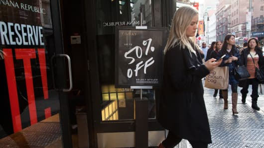 A shopper leaves a Banana Republic store in New York.