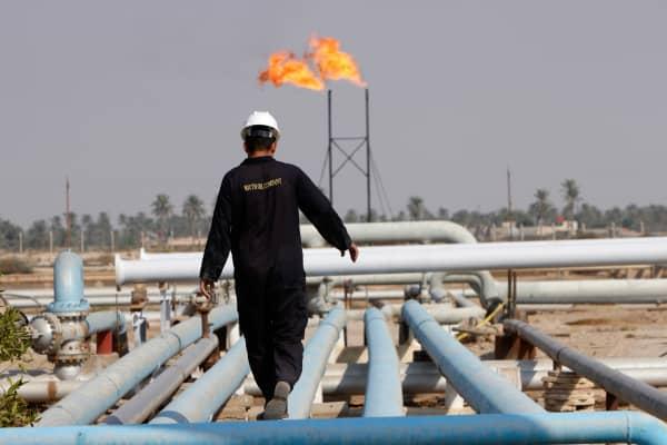 A worker walks at the Nahr Bin Umar field, Iraq.