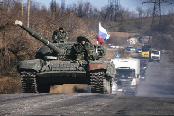 Pro-Russian separatists ride on top of a tank near the town of Krasnyi Luch in Lugansk region, eastern Ukraine, on October 28, 2014.