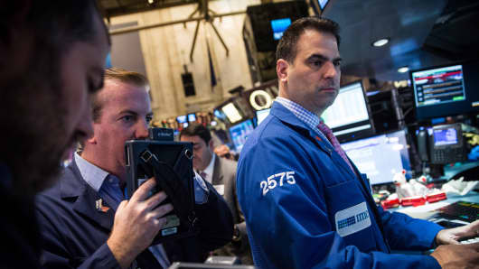 Traders work on the floor of the New York Stock Exchange on the morning of November 28, 2014 in New York City.