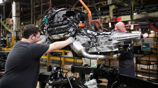 An engine is installed into a Chrysler Ram 1500 truck as it goes through the assembly line at the Warren Truck Assembly Plant September 25, 2014 in Warren, Michigan.