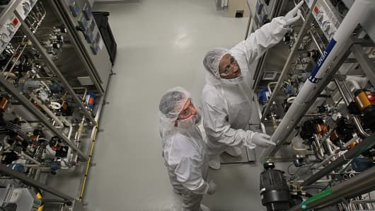 File photo: Michael LeClair, left, and Kevin Fleurimond, in the manufacturing room of Biogen Idec.