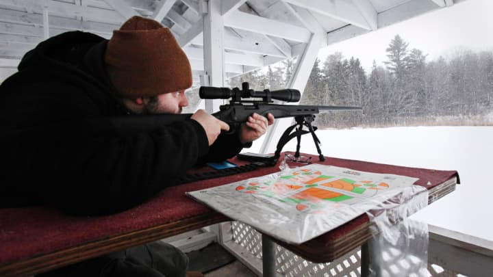 A shooter takes aim with a Remington Model 700 SPS Varmint rifle at the Spurwink Rod and Gun Club in Cape Elizabeth, Maine, Jan. 28, 2013.