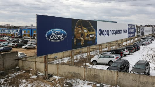 A billboard promotes the Ford Kuga outside a Ford dealership in Moscow, April 3, 2014.
