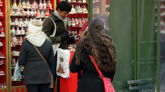 Shoppers browse the various Holiday shops in Bryant Park, New York City.