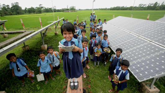 School students near the Solar Energy compound at Moushuni in West Bengal, India