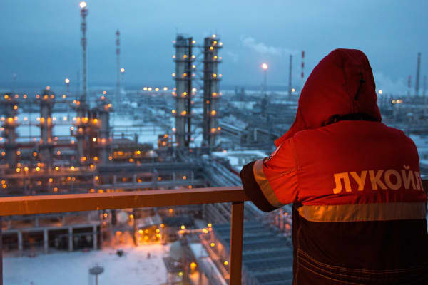 An employee looks out over the petroleum-cracking complex at the Lukoil-Nizhegorodnefteorgsintez oil refinery in Nizhny Novgorod, Russia.