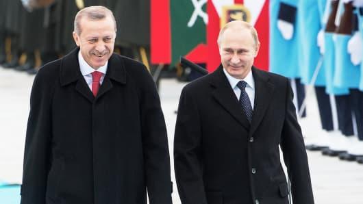 Russian President Vladimir Putin (R) Turkish President Recep Tayyip Erdogan (L) seen during a welcoming ceremony in Ankara, Turkey on Dec. 1st, 2014.