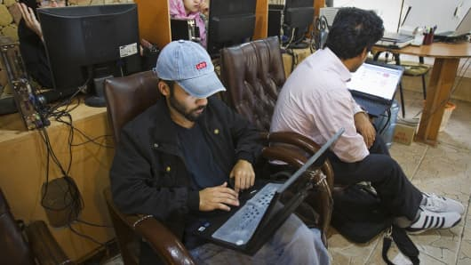 Customers use computers at an Internet cafe in Tehran, Iran.