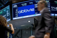 A screen displays the share price for pharmaceutical maker AbbVie on the floor of the New York Stock Exchange, July 18, 2014.