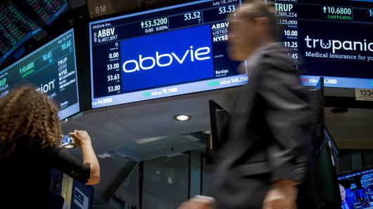 A screen displays the share price for pharmaceutical maker AbbVie on the floor of the New York Stock Exchange.