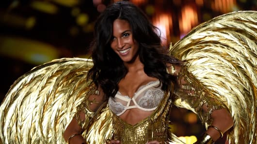 Model Cindy Bruna walks the runway at the annual Victoria's Secret fashion show at Earls Court on Dec. 2, 2014, in London.