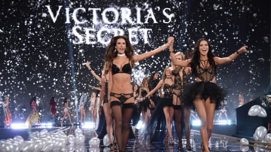 Victoria's Secret models Alessandra Ambrosio and Adriana Lima (R) walk the runway during finale of the 2014 Victoria's Secret Fashion Show at Earls Court Exhibition Centre on Dec. 2, 2014, in London.
