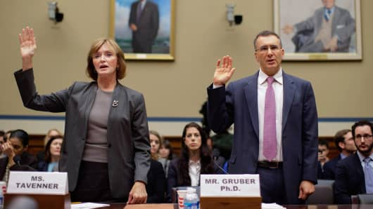 Centers for Medicare and Medicaid Services Administrator Marilyn Tavenner (L) and Massachusetts Institute of Technology Economics professor Jonathan Gruber are sworn in before the House Oversight and Government Reform Committee during a hearing about the Affordable Care Act in the Rayburn House Office building on Capitol Hill December 9, 2014 in Washington, DC.