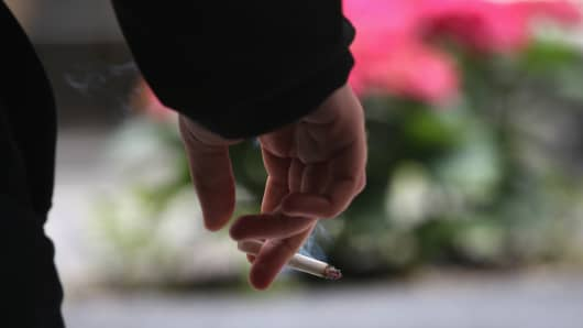 A man enjoys a cigarette in midtown Manhattan.