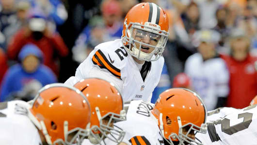 Cleveland Browns' quarterback Johnny Manziel (2) lines up under the center during a game against the Buffalo Bills in Orchard Park, N.Y., Nov. 30, 2014.