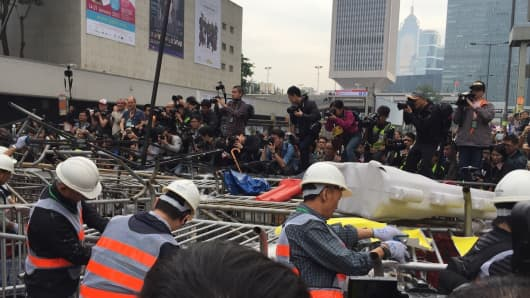 Hong Kong authorities clearing barricades on December 11, 2014