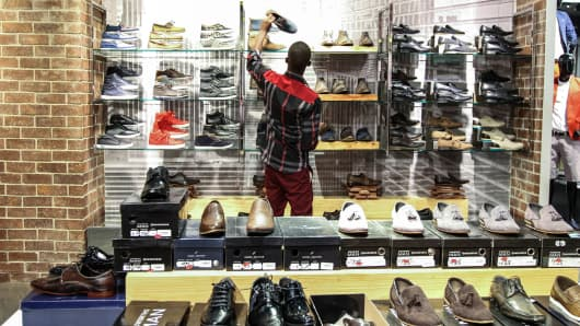 A customer browses men's shoes in the footwear department inside a Truworths International Ltd. fashion store in Sandton, South Africa