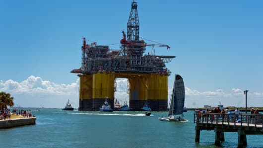 People gather to watch the Royal Dutch Shell Plc Olympus tension leg platform (TLP) set sail from Kiewit Offshore Services in Port Aransas, Texas.