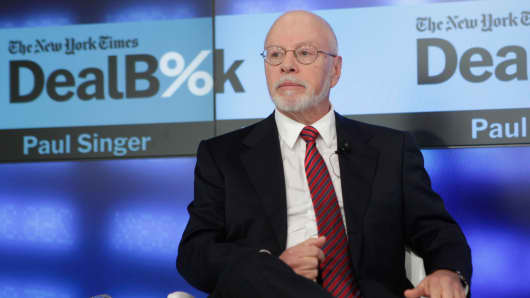 Founder and president of the Elliot Management Corp., Paul Singer, speaks during The New York Times DealBook Conference on Dec. 11, 2014, in New York City.