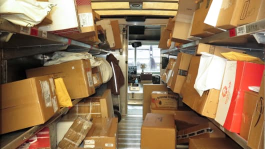A UPS truck is loaded with packages from the UPS Worldport.
