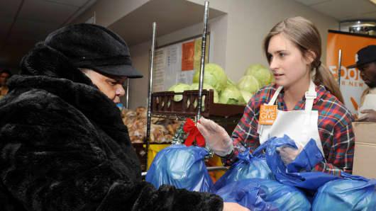 Founder of FEED, Lauren Bush Lauren, attends Feeding America Hosts Bi-Coastal Celebrity Volunteer Event at Food Bank for New York City's Community Kitchen & Food Pantry on December 11, 2014, in New York City.