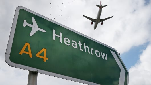 An airliner comes in to land at Heathrow Airport in London, Aug. 11, 2014.