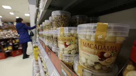 Plastic containers of Macadamia nuts for sale are displayed at a store in Seoul, South Korea, Monday, Dec. 15, 2014. Nut rage imploded the career of a Korean Air Lines executive and embarrassed her family and country. Now South Korean retailers are experiencing the unexpected upside: a boom in sales of macadamias.