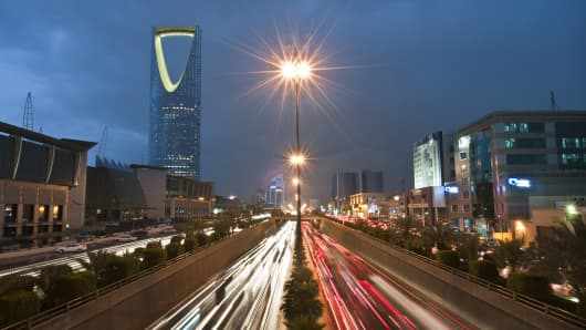 Vehicle light trails pass the Kingdom Tower on King Fahad Road in Riyadh, Saudi Arabia.