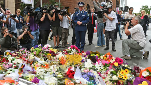 A memorial at the scene of a dramatic siege which left two hostages dead in Sydney on December 16, 2014