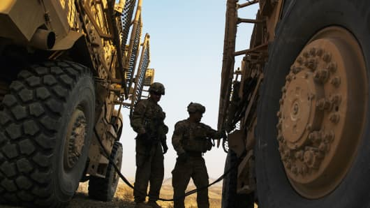U.S. soldiers with military vehicles during a training mission in the Laghman province of Afghanistan, December 15, 2014.