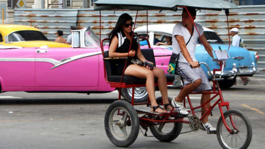 A taxi bike near the Capitolium square in Havana, Cuba.