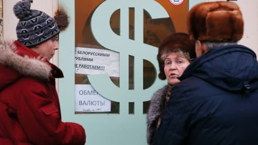 People gather near a currency exchange office in Moscow, Dec. 17, 2014.