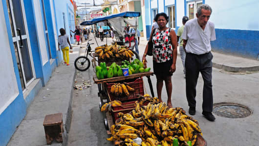 Cubans buy fruits and vegetables in a street of Santiago de Cuba.