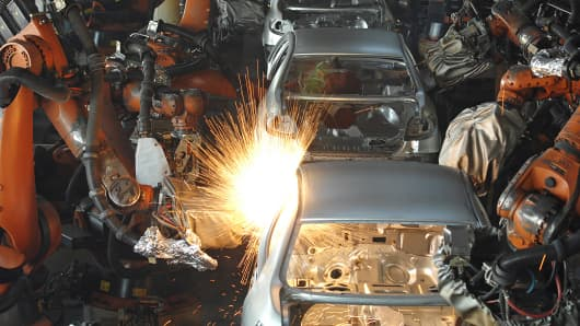 Robotic arms weld car bodies at the automated Khodro auto plant in Tehran, Iran, Dec. 9, 2013.