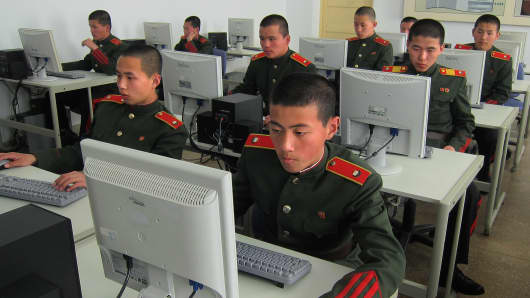 File photo of students at the Mangyongdae Revolutionary School, in Pyongyang, North Korea, work on computers.