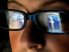 Facebook logo reflection in eyeglass