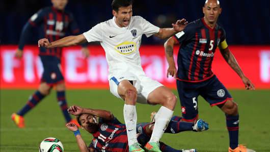 Pablo Barrientos of San Lorenzo tackles Mario Bilen of Auckland City during the FIFA Club World Cup Semi Final match between CA San Lorenzo and Auckland City FC at Marrakech Stadium on December 17, 2014 in Marrakech, Morocco.
