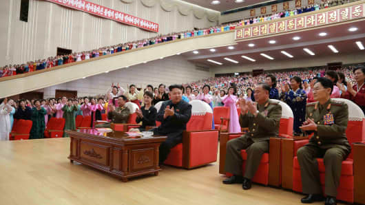 Korean leader Kim Jong Un and his wife, Ri Sol Ju, attend the Second Meeting of Korean People's Army (KPA) Exemplary Servicemen's Families performance of art groups.