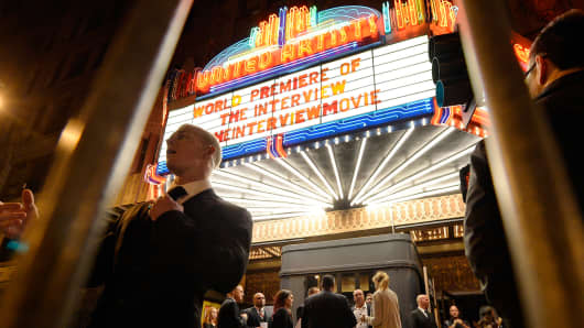 "Security guards at the entrance of United Artists theater during the premiere of the film ""The Interview"" in Los Angeles, December 11, 2014."