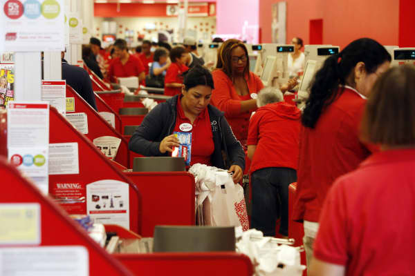 Target employees at the checkout registers at a Target store in Torrance, California.