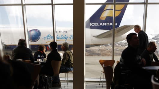 An Icelandair airplane sits on the tarmac as travelers wait for a flight inside the Akureyi Airport, in this April 24, 2010 photo in Akureyi, Iceland.