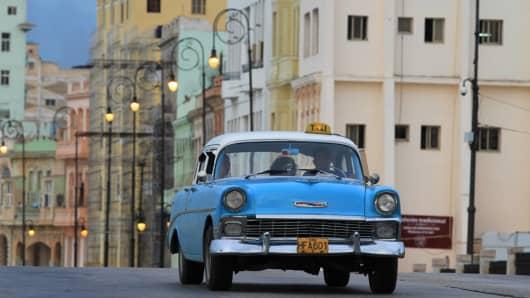 A classic taxi car cruises the streets of Havana, Cuba.