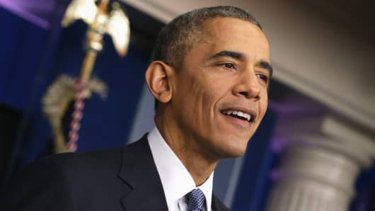 President Barack Obama speaks during his last news conference of the year in the James Brady Press Briefing Room of the White House December 19, 2014 in Washington.