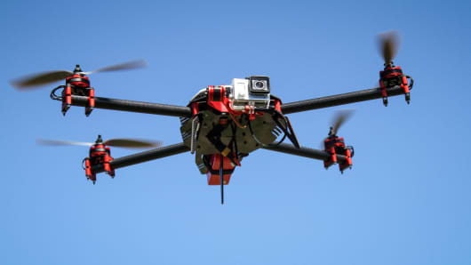 A SteadiDrone QU4D aerial drone fitted with a GoPro video camera.