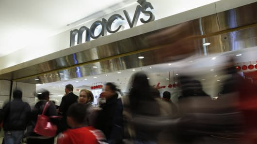 People enter to Macy's store at the Newport Mall in Jersey City, N.J.
