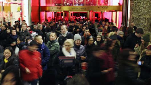 Customers walk through Macy's in New York ahead of Black Friday, on Thursday, Nov. 27, 2014.