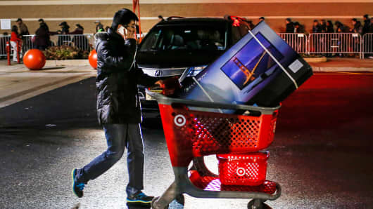 A shopper pushes a cart loaded with a TV outside a Target store in Newport, New Jersey.