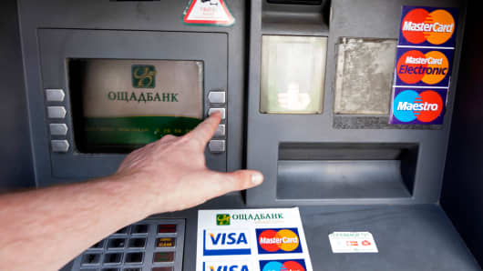 An automated teller machine operated by OAO Sberbank in Kiev, Ukraine.