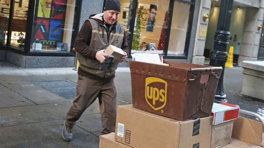 A UPS worker delivers packages in Chicago, Dec. 26, 2013.